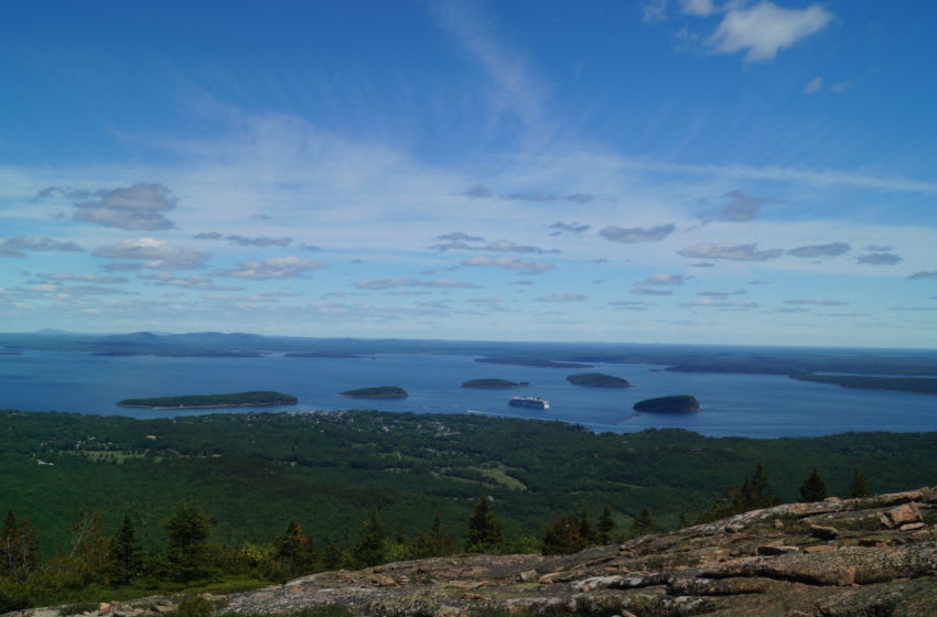 The town of Bar Harbor, Maine sits along the coast below Cadillac Mountain.