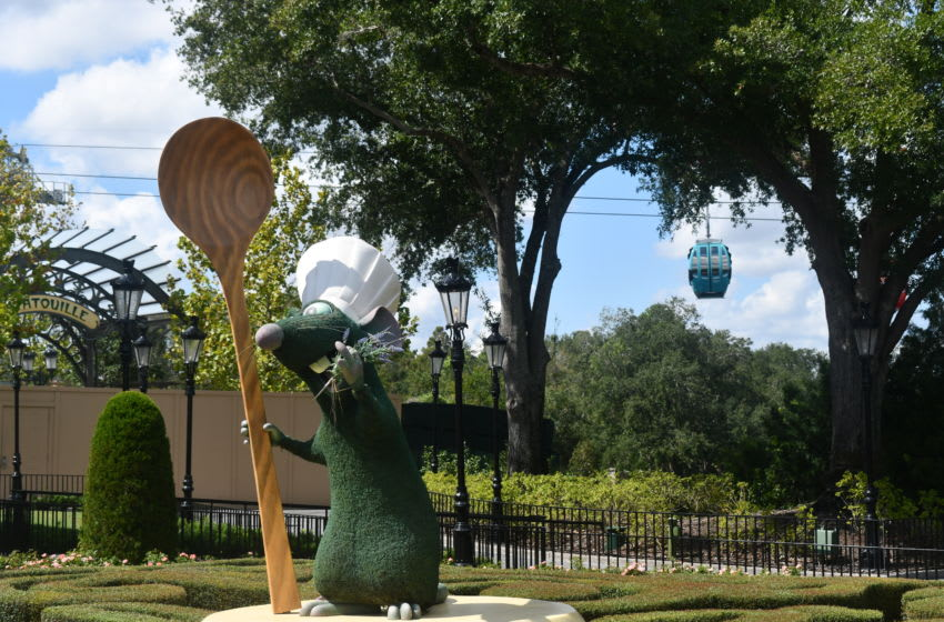 Remmy topiary greets guests at the entrance to the France pavilion at Epcot