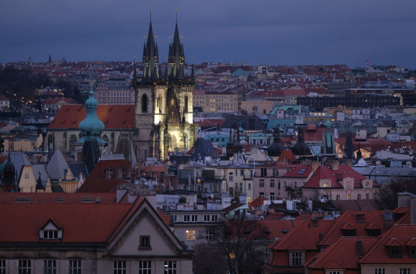PRAGUE, CZECH REPUBLIC - DECEMBER 25: Historic buildings, including the Tyn Church with its twin spires, stand in the city center at twilight on December 25, 2018 in Prague, Czech Republic. Prague is among Europe's most popular tourist destinations. (Photo by Sean Gallup/Getty Images)