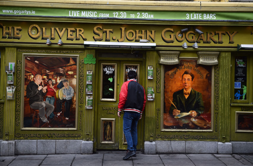 DUBLIN, IRELAND - MARCH 10: A man checks to see if a bar in the Temple Bar district is open following the cancellation of the annual Saint Patricks Day parade and celebrations on March 17, 2020 in Dublin, Ireland. The event that draws thousands of visitors to the island from across the world was cancelled by the Irish government in their response to the Covid-19 virus pandemic. (Photo by Charles McQuillan/Getty Images)
