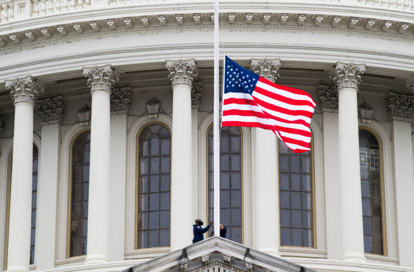 WASHINGTON, DC - SEPTEMBER 25: A flag at the U.S. Capitol is lowered to half-mast in honor of Associate Justice Ruth Bader Ginsburg on September 25, 2020 in Washington, DC. Ginsburg, who was appointed by former U.S. President Bill Clinton, served on the high court from 1993, until her death on September 18, 2020. She is the first woman to lie in state at the Capitol. (Photo by Liz Lynch/Getty Images)