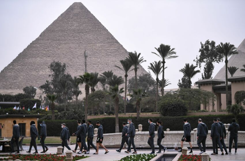 France's national team players walk in their hotel in front of Giza Pyramids, on January 13, 2021 in the Egyptian capital Cairo on the eve of the 2021 World Men's Handball Championship match between Group E teams Norway and France. (Photo by Anne-Christine POUJOULAT / AFP) (Photo by ANNE-CHRISTINE POUJOULAT/AFP via Getty Images)
