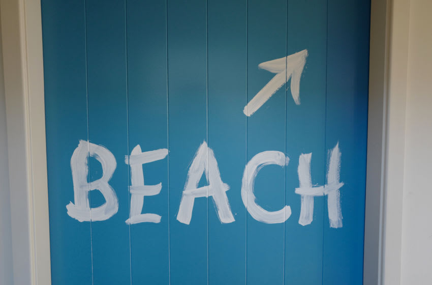 A sign directing people to the beach at a house on June 19, 2020 in Culburra Beach, NSW, Australia. Tourism in NSW has begun to re-surface after the initial spike of the Coronavirus pandemic and tourism operators have started to return following a sharp decline in tourists visiting the area.