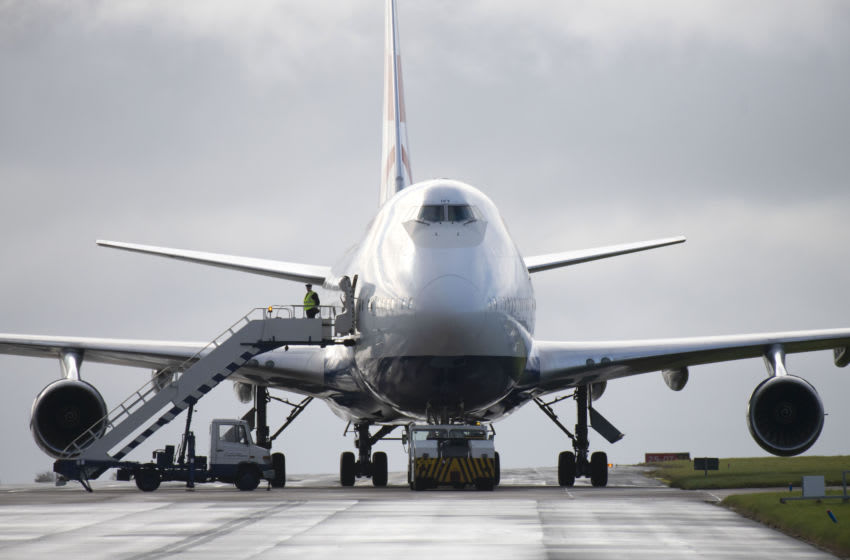 ST. ATHAN, WALES - OCTOBER 8: British Airways crew depart a Boeing 747-400 (G-CIVY) aircraft for the last time after it arrives at St. Athan airport on October 8, 2020 in St. Athan, Wales. The aircraft has clocked-up 45 million air miles having first flown in September 1998. Two Heathrow-based Boeing 747 aircraft set off for their last flights, one to Kemble airport and the other to an airfield near Cardiff. British airways have brought forward the jumbo jets retirement by several years due to the financial impact of the Coronavirus pandemic on the airline. (Photo by Matthew Horwood/Getty Images)