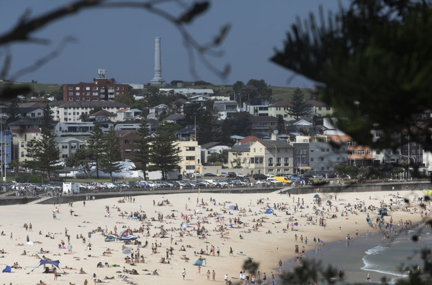 SYDNEY, AUSTRALIA - JANUARY 14: A general view of a busy Bondi Beach on January 14, 2021 in Sydney, Australia. New South Wales recorded no new locally acquired cases of COVID-19 in the last 24 hour reporting period. The last time there were no locally acquired cases in NSW was on 6 January 2021. (Photo by Brook Mitchell/Getty Images)