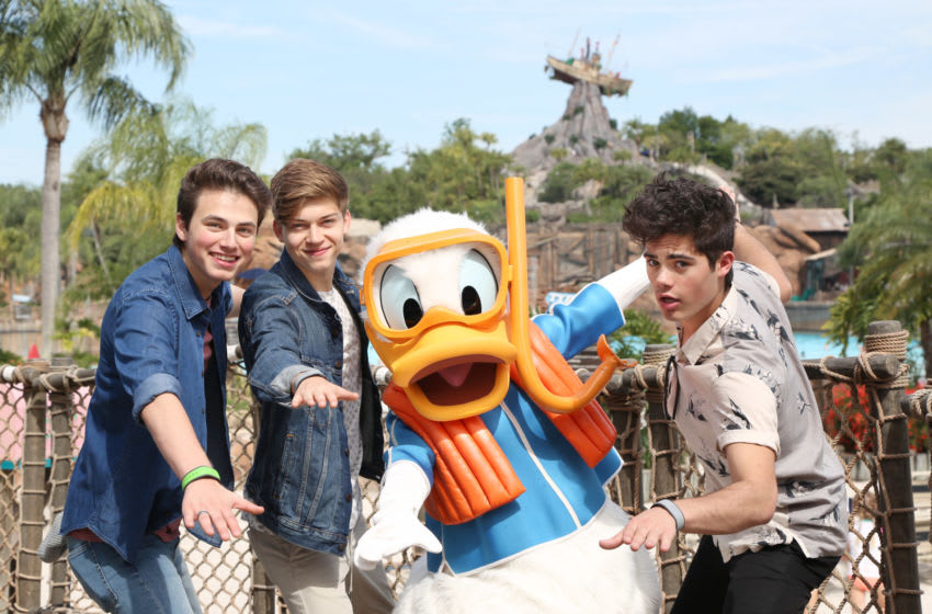 LAKE BUENA VISTA, FLORIDA - MAY 15: (L-R) Emery Kelly, Liam Attridge and Ricky Garcia of the music group Forever in Your Mind join Donald Duck at Disney's Typhoon Lagoon at the Walt Disney World Resort on May 15, 2016 in Lake Buena Vista, Florida. (Photo by Gregg Newton/ Disney Resorts via Getty Images)