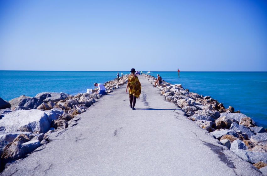 VENICE, FL - DECEMBER 3: Person wearing a black hat walking on a concrete jetty December 3, 2016 in Venice, Florida ( Photo by Neil G. Phillips/Getty Images)