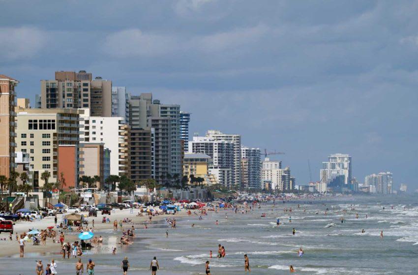Beachgoers look to enjoy the beach weather in Daytona Beach Shores, Sunday, Oct. 11, 2020. Beachweather06