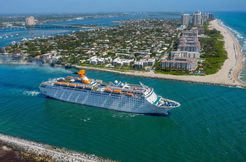 The Grand Celebration cruise ship sails through the Lake Worth Inlet between Palm Beach and Singer Island, Florida, after leaving the Port of Palm Beach to avoid Hurricane Isaias on July 31, 2020. [GREG LOVETT/palmbeachpost.com]