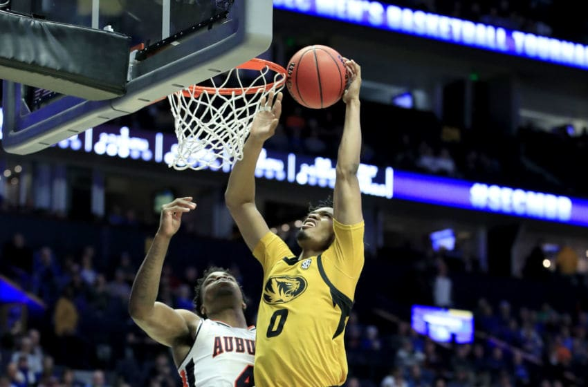 NASHVILLE, TENNESSEE - MARCH 14: Torrence Watson #0 of the Missouri Tigers shoots the ball against the Auburn Tigers during the second round of the SEC Basketball Tournament at Bridgestone Arena on March 14, 2019 in Nashville, Tennessee. (Photo by Andy Lyons/Getty Images)