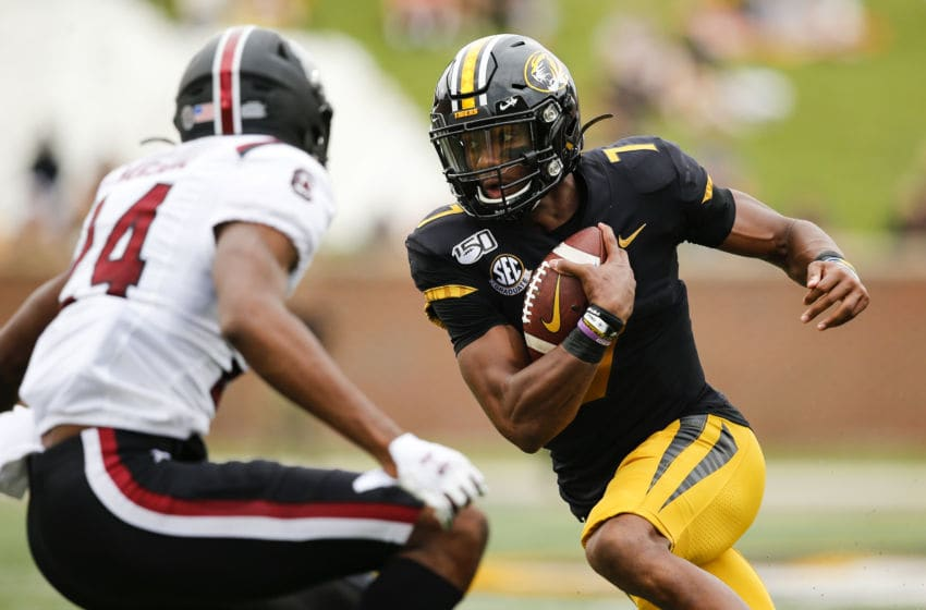COLUMBIA, MO - SEPTEMBER 21: Kelly Bryant #7 of the Missouri Tigers runs past Israel Mukuamu #24 of the South Carolina Gamecocks in the first quarter at Faurot Field/Memorial Stadium on September 21, 2019 in Columbia, Missouri. (Photo by David Eulitt/Getty Images)