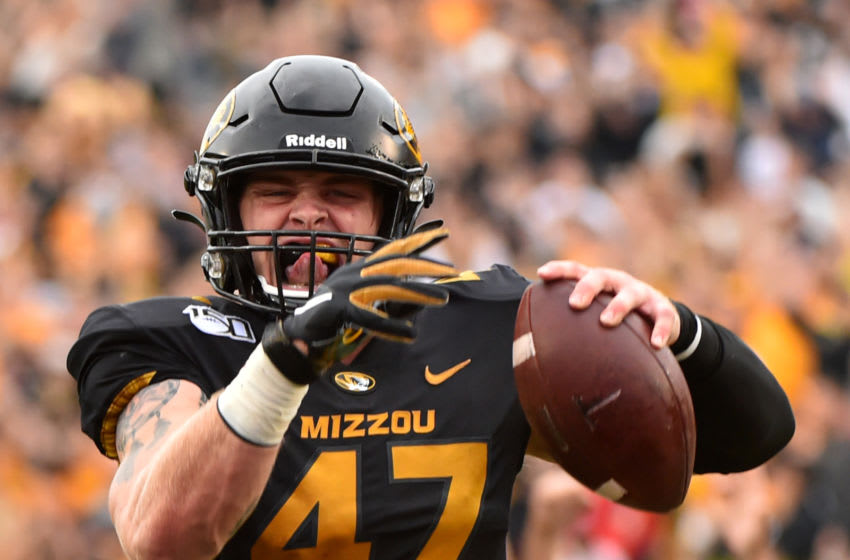 COLUMBIA, MISSOURI - OCTOBER 05: Linebacker Cale Garrett #47 of the Missouri Tigers celebrates as he runs for touchdown after intercepting a pass against the Troy Trojan sin the second quarter at Faurot Field/Memorial Stadium on October 05, 2019 in Columbia, Missouri. (Photo by Ed Zurga/Getty Images)