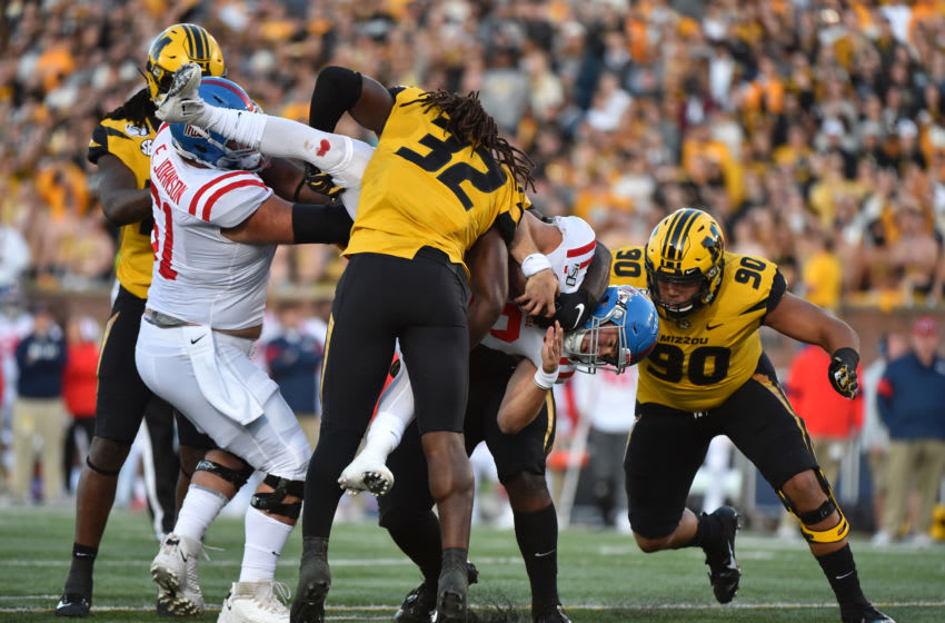 COLUMBIA, MISSOURI - OCTOBER 12: Quarterback John Rhys Plumlee #10 of the Mississippi Rebels is tackled by linebacker Nick Bolton #32 and defensive lineman Markell Utsey #90 of the Missouri Tigers in the first quarter at Faurot Field/Memorial Stadium on October 12, 2019 in Columbia, Missouri. (Photo by Ed Zurga/Getty Images)