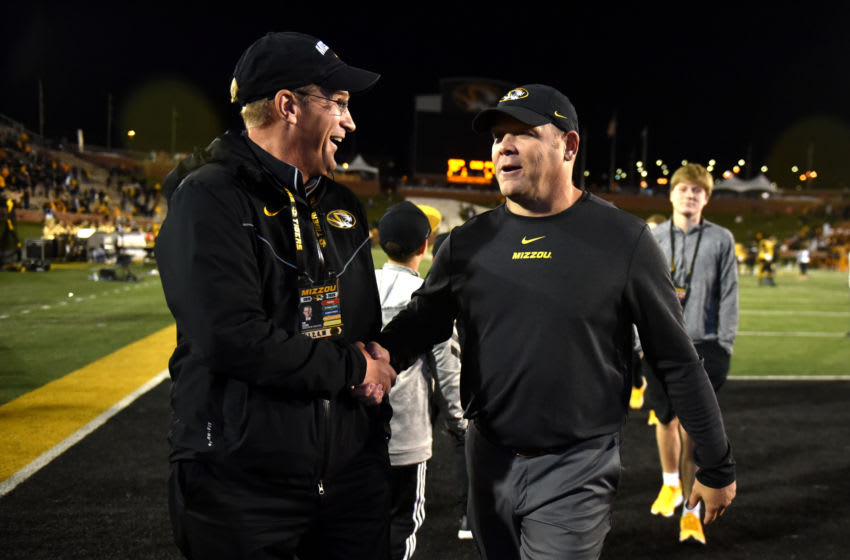 COLUMBIA, MISSOURI - OCTOBER 12: Head coach Barry Odom of the Missouri Tigers (R) celebrates a 38-27 win over the Mississippi Rebels with athletic director Jim Sterk at Faurot Field/Memorial Stadium on October 12, 2019 in Columbia, Missouri. (Photo by Ed Zurga/Getty Images)