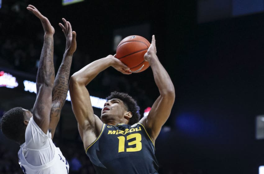 CINCINNATI, OH - NOVEMBER 12: Mark Smith #13 of the Missouri Tigers shoots the ball against Naji Marshall #13 of the Xavier Musketeers at Cintas Center on November 12, 2019 in Cincinnati, Ohio. (Photo by Michael Hickey/Getty Images)