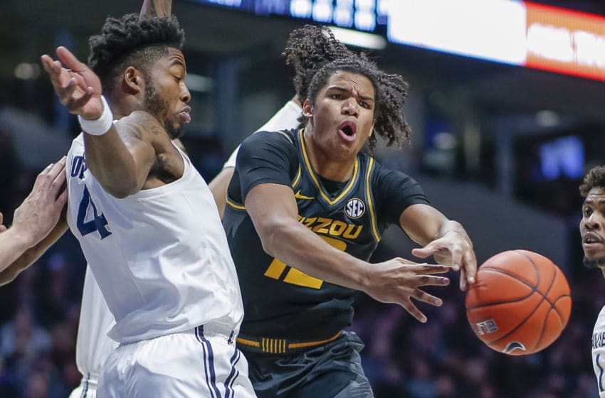 CINCINNATI, OH - NOVEMBER 12: Dru Smith #12 of the Missouri Tigers loses the ball in the lane as Tyrique Jones #4 of the Xavier Musketeers defends during the first half at Cintas Center on November 12, 2019 in Cincinnati, Ohio. (Photo by Michael Hickey/Getty Images)