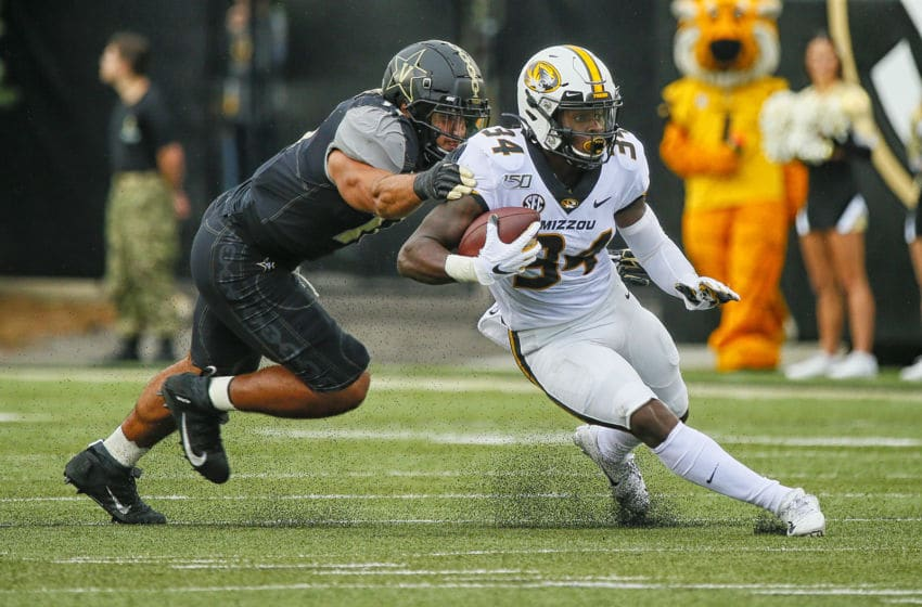 NASHVILLE, TENNESSEE - OCTOBER 19: Larry Rountree III #34 of the Missouri Tigers rushes against the Vanderbilt Commodores during the first half at Vanderbilt Stadium on October 19, 2019 in Nashville, Tennessee. (Photo by Frederick Breedon/Getty Images)
