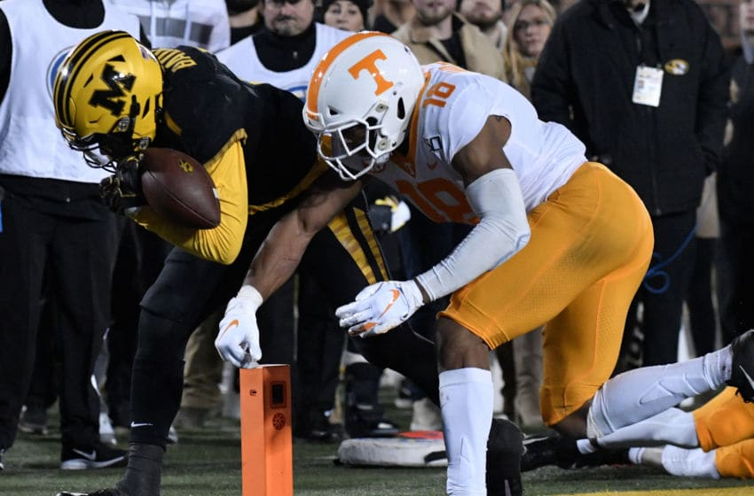 COLUMBIA, MISSOURI - NOVEMBER 23: Running back Tyler Badie #1 of the Missouri Tigers goes in for a touchdown against defensive back Nigel Warrior #18 of the Tennessee Volunteers in the second quarter at Faurot Field/Memorial Stadium on November 23, 2019 in Columbia, Missouri. (Photo by Ed Zurga/Getty Images)