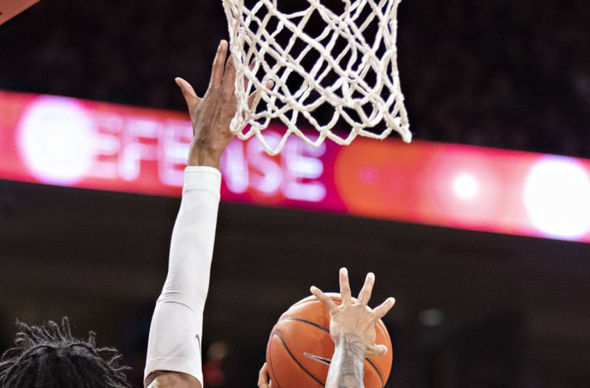 FAYETTEVILLE, AR - FEBRUARY 22: Xavier Pinson #1 of the Missouri Tigers goes up for a shot in the first half against Jimmy Whitt Jr. #33 of the Arkansas Razorbacks at Bud Walton Arena on February 22, 2020 in Fayetteville, Arkansas. (Photo by Wesley Hitt/Getty Images)