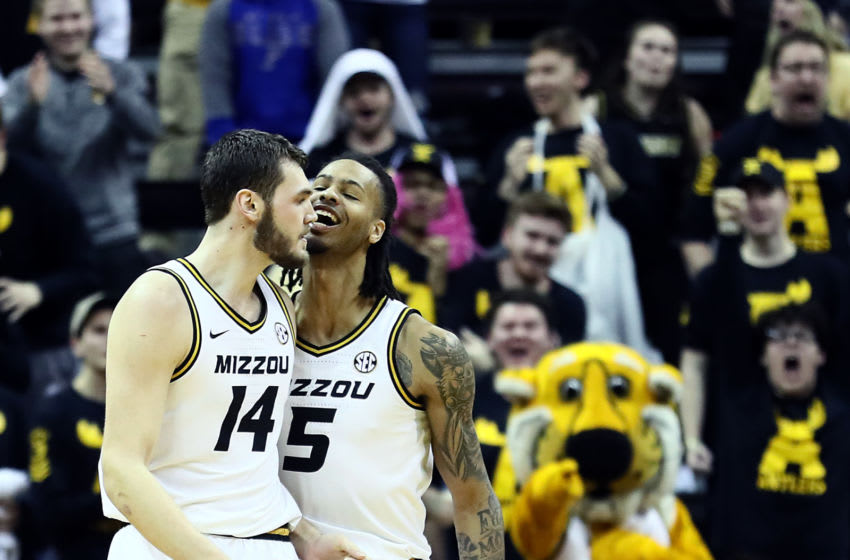 COLUMBIA, MISSOURI - JANUARY 28: Mitchell Smith #5 of the Missouri Tigers celebrates with Reed Nikko #14 as the Tigers defeat the Georgia Bulldogs 72-69 to win the game at Mizzou Arena on January 28, 2020 in Columbia, Missouri. (Photo by Jamie Squire/Getty Images)