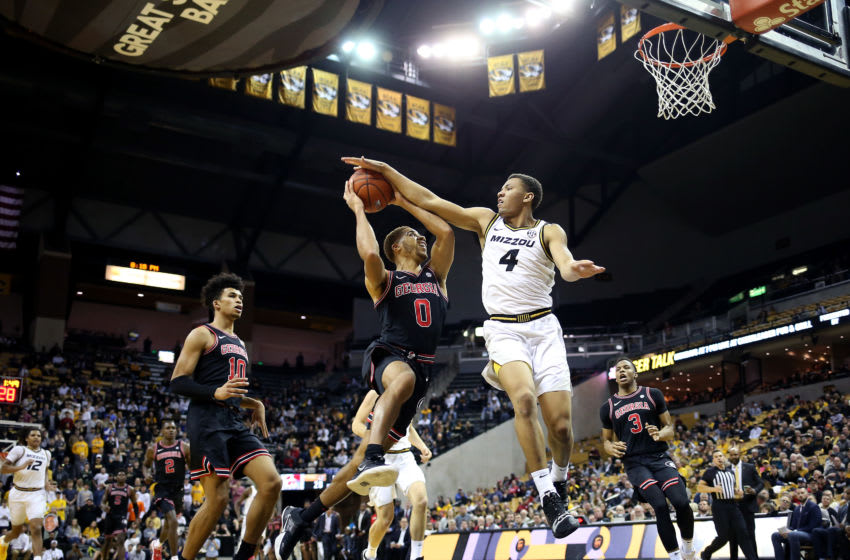 COLUMBIA, MISSOURI - JANUARY 28: Javon Pickett #4 of the Missouri Tigers blocks a shot by Donnell Gresham Jr. #0 of the Georgia Bulldogs during the game at Mizzou Arena on January 28, 2020 in Columbia, Missouri. (Photo by Jamie Squire/Getty Images)