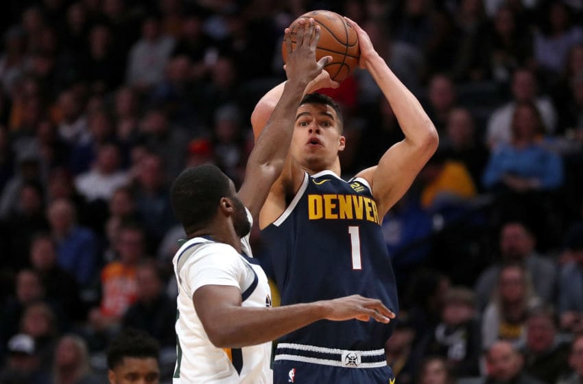 DENVER, COLORADO - JANUARY 30: Michael Porter Jr #1 of the Denver Nuggets puts up a shot over Emmanuel Mudiay #15 of the Utah Jazz in the first quarter at the Pepsi Center on January 30, 2020 in Denver, Colorado. NOTE TO USER: User expressly acknowledges and agrees that, by downloading and or using this photograph, User is consenting to the terms and conditions of the Getty Images License Agreement. (Photo by Matthew Stockman/Getty Images)