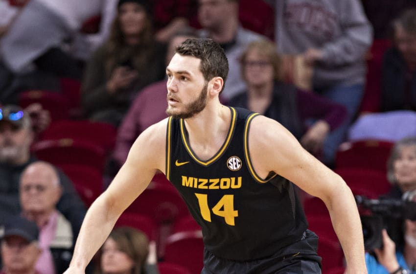 FAYETTEVILLE, AR - FEBRUARY 22: Reed Nikko #14 of the Missouri Tigers plays defense during a game against the Arkansas Razorbacks at Bud Walton Arena on February 22, 2020 in Fayetteville, Arkansas. The Razorbacks defeated the Tigers 78-68. (Photo by Wesley Hitt/Getty Images)