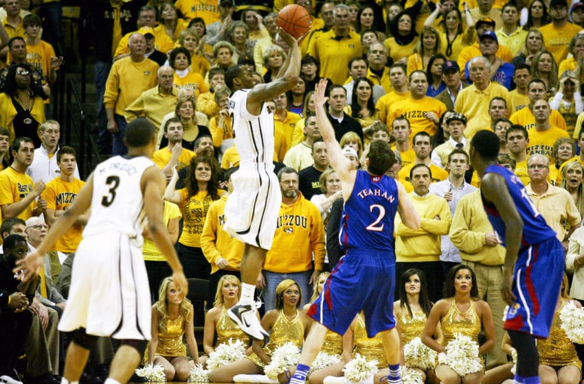 COLUMBIA, MO - FEBRUARY 04: Marcus Denmon #12 of the Missouri Tigers takes a shot over Conner Teahan #2 of the Kansas Jayhawks during the second half at Mizzou Arena on February 4, 2012 in Columbia, Missouri. Missouri won 74-71. (Photo by Ed Zurga/Getty Images)