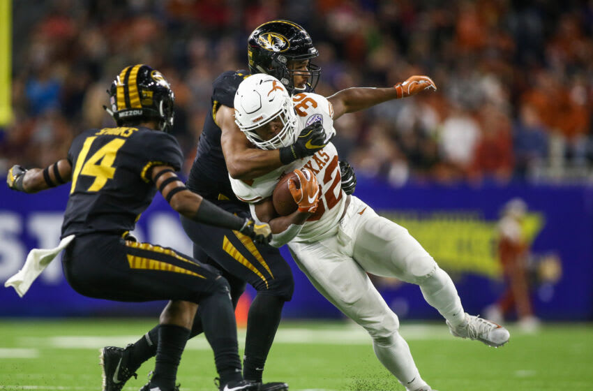 Dec 27, 2017; Houston, TX, USA; Missouri Tigers defensive back Adam Sparks (14) and defensive lineman Marcell Frazier (16) attempt to tackle Texas Longhorns running back Daniel Young (32) during the second quarter in the 2017 Texas Bowl at NRG Stadium. Mandatory Credit: Troy Taormina-USA TODAY Sports