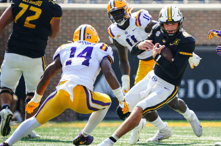 Oct 10, 2020; Columbia, Missouri, USA; Missouri Tigers quarterback Connor Bazelak (8) runs against LSU Tigers safety Maurice Hampton Jr. (14) during the first half at Faurot Field at Memorial Stadium. Mandatory Credit: Jay Biggerstaff-USA TODAY Sports
