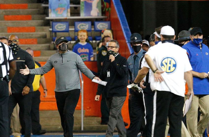 University of Missouri head coach Eliah Drinkwitz gestures toward University of Florida head coach Dan Mullen, far right, after a fight broke out at the end of the first half during a game against the Missouri Tigers at Ben Hill Griffin Stadium in Gainesville, Fla. Oct. 31, 2020. [Brad McClenny/The Gainesville Sun] Florida Missouri 06