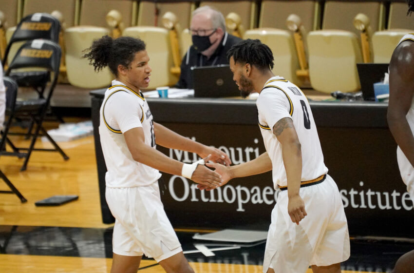 Mar 6, 2021; Columbia, Missouri, USA; Missouri Tigers guard Dru Smith (12) celebrates with guard Torrence Watson (0) after a Smith three point basket during the second half against the LSU Tigers at Mizzou Arena. Mandatory Credit: Denny Medley-USA TODAY Sports