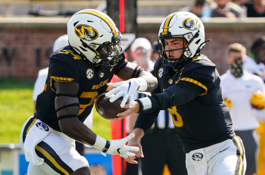 Oct 10, 2020; Columbia, Missouri, USA; Missouri Tigers quarterback Connor Bazelak (8) hands off to running back Larry Rountree III (34) during the first half against the LSU Tigers at Faurot Field at Memorial Stadium. Mandatory Credit: Jay Biggerstaff-USA TODAY Sports