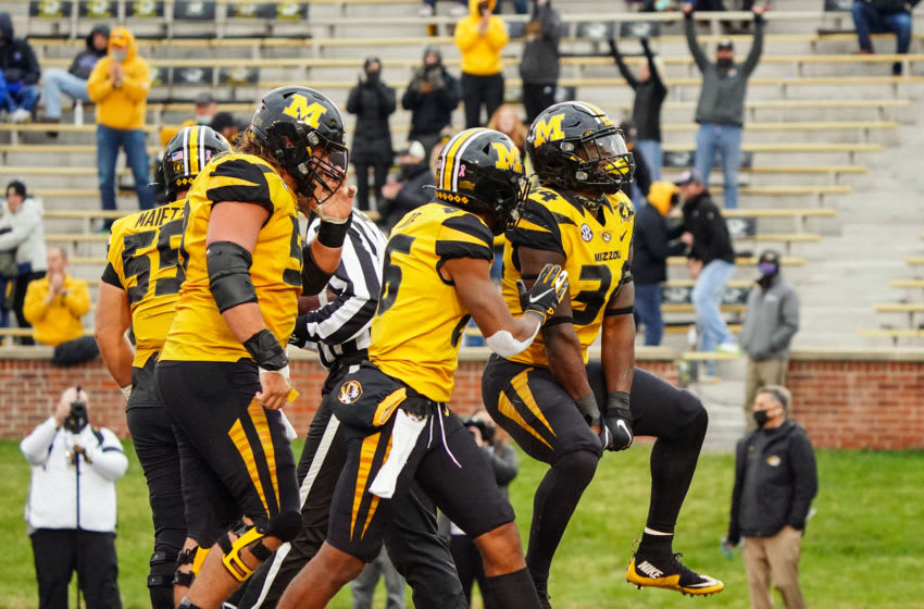 Oct 24, 2020; Columbia, Missouri, USA; Missouri Tigers running back Larry Rountree III (34) celebrates with teammates after scoring a touchdown against the Kentucky Wildcats during the second half at Faurot Field at Memorial Stadium. Mandatory Credit: Jay Biggerstaff-USA TODAY Sports