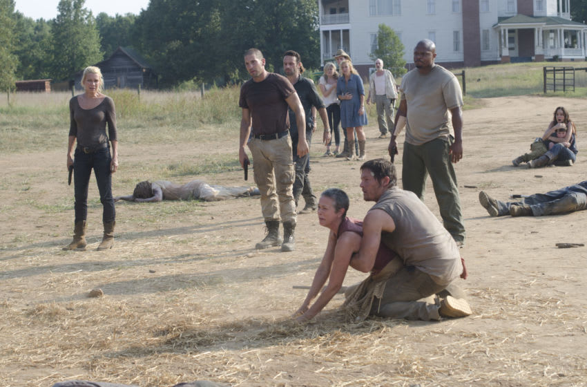 (Foreground) Carol (Melissa Suzanne McBride) and Daryl Dixon (Norman Reedus) - (Background L-R) Andrea (Laurie Holden), Shane Walsh (Jon Bernthal), Rick Grimes (Andrew Lincoln), Beth (Emily Kinney), Jimmy (James Alle McCune), Patricia (Jane McNeill), Dale (Jeffrey DeMunn), T-Dog (Robert 'IronE' Singleton), Carl Grimes (Chandler Riggs) and Lori Grimes (Sarah Wayne Callies) - The Walking Dead - Season 2, Episode 7 - Photo Credit: Gene Page/AMC