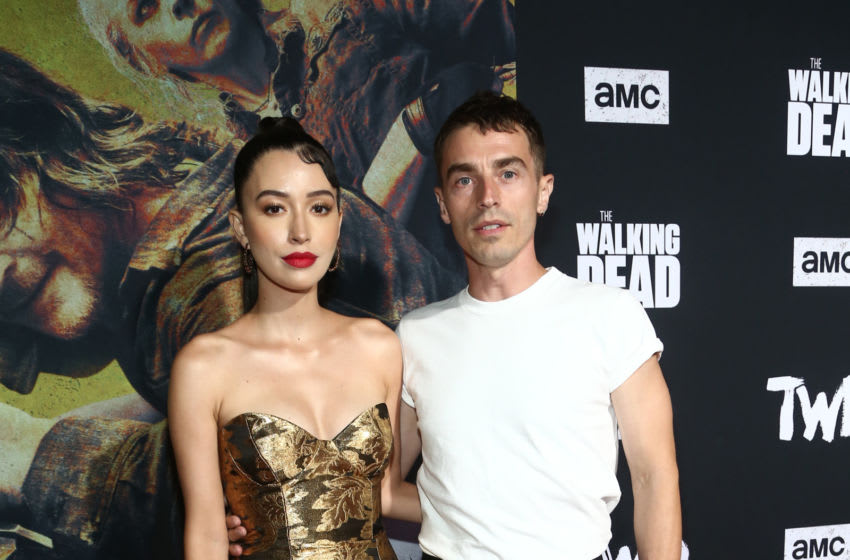 WEST HOLLYWOOD, CALIFORNIA - SEPTEMBER 23: Christian Serratos and David Boyd attend The Walking Dead Premiere and Party on September 23, 2019 in West Hollywood, California. (Photo by Tommaso Boddi/Getty Images for AMC)