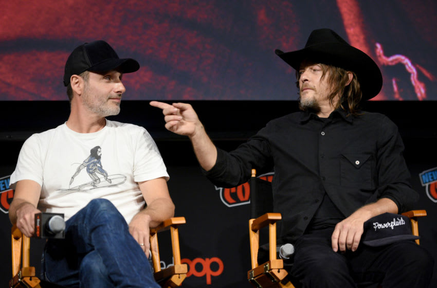 NEW YORK, NY - OCTOBER 06: Andrew Lincoln and Norman Reedus speak onstage during The Walking Dead panel during New York Comic Con at Jacob Javits Center on October 6, 2018 in New York City. (Photo by Andrew Toth/Getty Images for New York Comic Con)