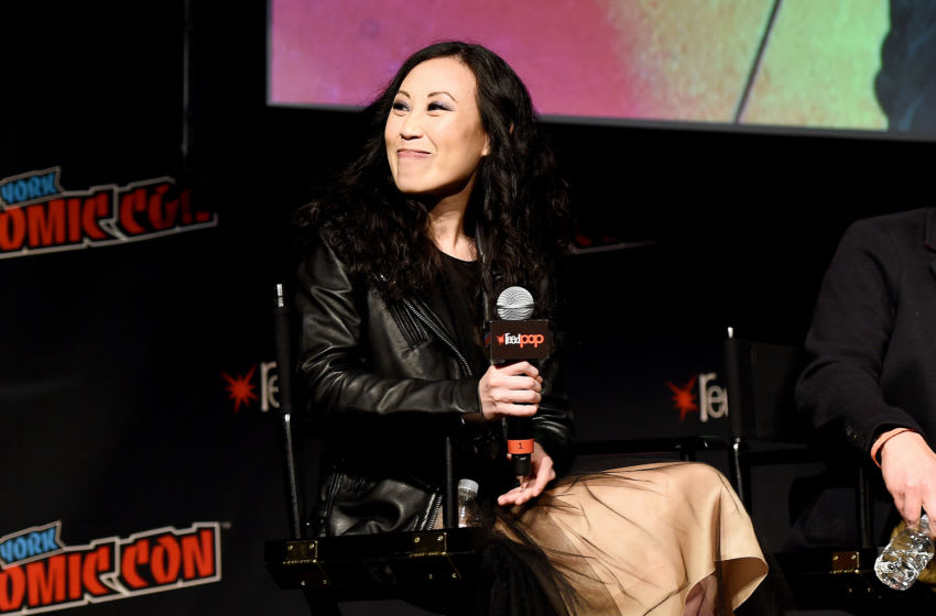 NEW YORK, NEW YORK - OCTOBER 05: Angela Kang speaks onstage during The Walking Dead Universe, Including AMC's Flagship Series and the Untitled New Third Series Within The Walking Dead Franchise at New York Comic Con 2019 Day 3 at Hulu Theater at Madison Square Garden October 05, 2019 in New York City. (Photo by Ilya S. Savenok/Getty Images for ReedPOP )