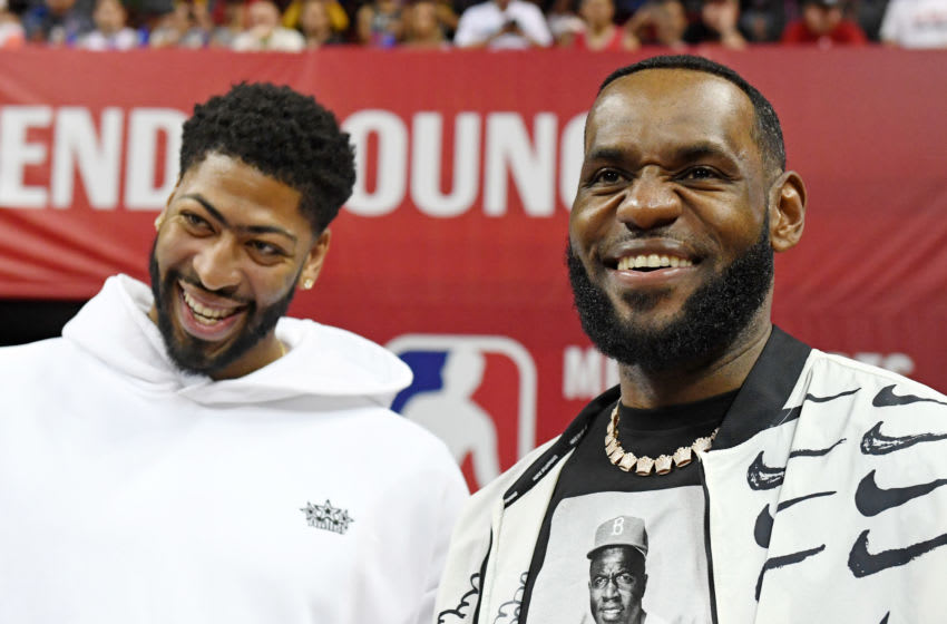 LAS VEGAS, NEVADA - JULY 06: Anthony Davis (L) and LeBron James of the Los Angeles Lakers arrive at a game between the Lakers and the LA Clippers during the 2019 NBA Summer League at the Thomas & Mack Center on July 6, 2019 in Las Vegas, Nevada. NOTE TO USER: User expressly acknowledges and agrees that, by downloading and or using this photograph, User is consenting to the terms and conditions of the Getty Images License Agreement. (Photo by Ethan Miller/Getty Images)