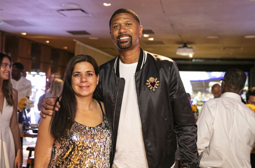 DETROIT, MICHIGAN - AUGUST 25: Current sports analyst for ESPN, and cofounder of the Jalen Rose Leadership Academy Jalen Rose poses with his publicist at the MGM Casino's Topgolf Swing Suite on August 25, 2019 in Detroit, Michigan. (Photo by Scott Legato/Getty Images for Jalen Rose Leadership Academy)