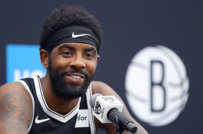 NEW YORK, NEW YORK - SEPTEMBER 27: Kryie Irving #11 of the Brooklyn Nets speaks to media during Brooklyn Nets Media Day at HSS Training Center on September 27, 2019 in the Brooklyn Borough of New York City. NOTE TO USER: User expressly acknowledges and agrees that, by downloading and or using this photograph, User is consenting to the terms and conditions of the Getty Images License Agreement. (Photo by Mike Lawrie/Getty Images)