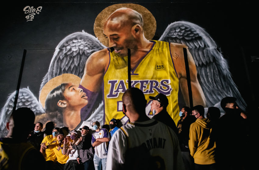 LOS ANGELES, CA - OCTOBER 11: Lakers fans stand in line to celebrate in front of a mural of Kobe Bryant and his daughter Gianna Bryant on October 11, 2020 in Los Angeles, California. People gathered to celebrate after the Los Angeles Lakers defeated the Miami Heat in Game 6 of the NBA Finals. (Photo by Brandon Bell/Getty Images)