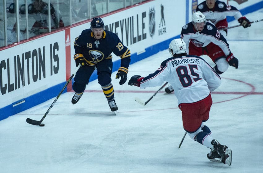 CLINTON, NY - SEPTEMBER 25: Buffalo Sabers Right Defenseman Jake McCabe (19) skates with the puck with Columbus Blue Jackets Center Michael Prapavessis (85) in pursuit during the first period of the Columbus Blue Jackets versus the Buffalo Sabers preseason game on September 25, 2018, at Clinton Arena in Clinton, New York. (Photo by Gregory Fisher/Icon Sportswire via Getty Images)