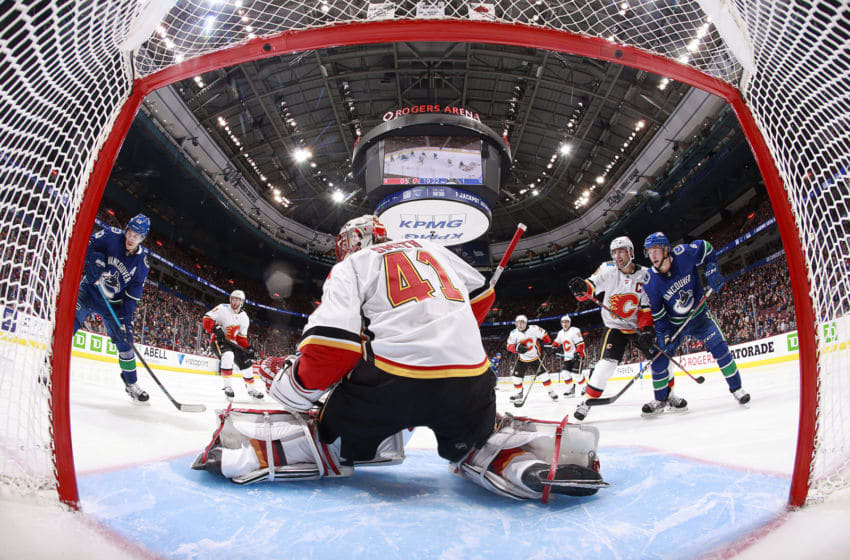 VANCOUVER, BC - OCTOBER 3: Mike Smith #41 of the Calgary Flames looks on from his crease during their NHL game against the Vancouver Canucks at Rogers Arena October 3, 2018 in Vancouver, British Columbia, Canada. (Photo by Jeff Vinnick/NHLI via Getty Images)