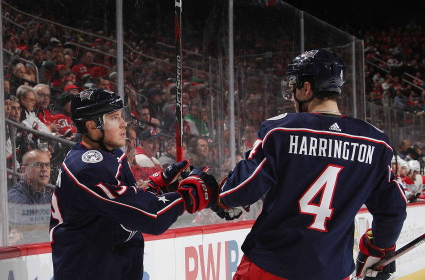 NEWARK, NEW JERSEY - DECEMBER 23: Cam Atkinson #13 of the Columbus Blue Jackets celebrates his goal against the New Jersey Devils at 4:13 of the first period and is joined by Scott Harrington #4 at the Prudential Center on December 23, 2018 in Newark, New Jersey. (Photo by Bruce Bennett/Getty Images)