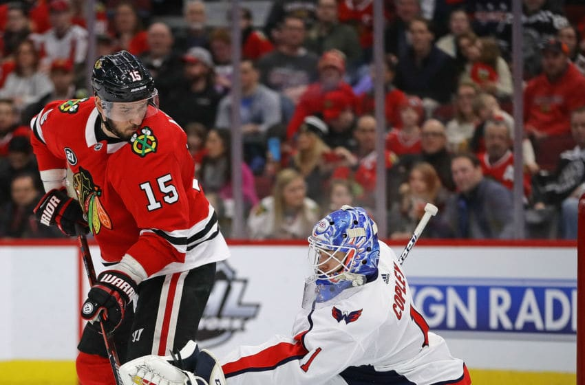 CHICAGO, ILLINOIS - JANUARY 20: Pheonix Copley #1 of the Washington Capitals makes a save against Artem Anisimov #15 of the Chicago Blackhawks at the United Center on January 20, 2019 in Chicago, Illinois. (Photo by Jonathan Daniel/Getty Images)