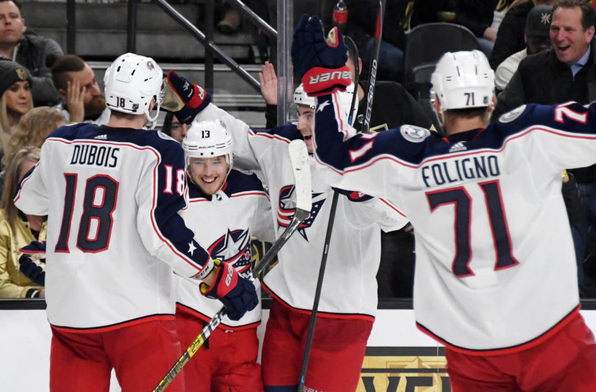 LAS VEGAS, NEVADA - FEBRUARY 09: Pierre-Luc Dubois #18, Cam Atkinson #13, Zach Werenski #8 and Nick Foligno #71 of the Columbus Blue Jackets celebrate after Werenski assisted Atkinson on his second goal of the third period against the Vegas Golden Knights during their game at T-Mobile Arena on February 9, 2019 in Las Vegas, Nevada. The Blue Jackets defeated the Golden Knights 4-3. (Photo by Ethan Miller/Getty Images)