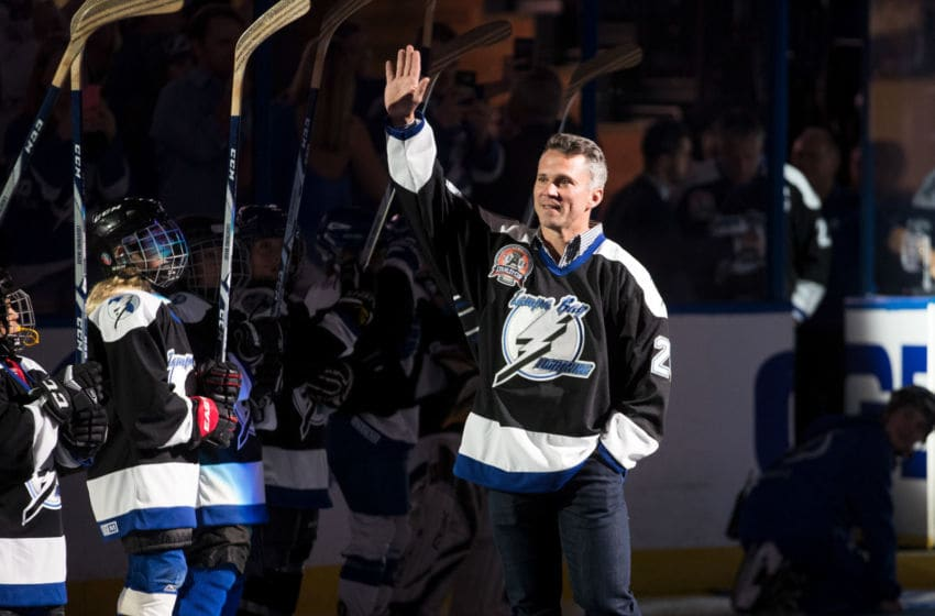 TAMPA, FL - NOVEMBER 4: Martin St. Louis #26 waves to fans as the Tampa Bay Lightning honor the 2004 Stanley Cup Champions as part of their 25th anniversary celebration before the game against the Columbus Blue Jackets at Amalie Arena on November 4, 2017 in Tampa, Florida. (Photo by Scott Audette/NHLI via Getty Images)