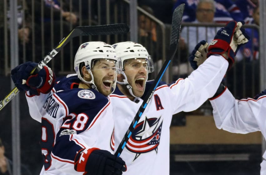 NEW YORK, NY - NOVEMBER 06: Oliver Bjorkstrand #28 of the Columbus Blue Jackets (l) ceebrates his goal at 8:01 of the third period against the New York Rangers and is joined by Boone Jenner #38 (r) at Madison Square Garden on November 6, 2017 in New York City. The Rangers defeated the Blue Jackets 5-3. (Photo by Bruce Bennett/Getty Images)