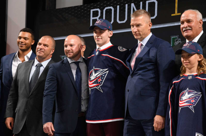 DALLAS, TX - JUNE 22: Liam Foudy poses onstage after being selected eighteenth overall by the Columbus Blue Jackets during the first round of the 2018 NHL Draft at American Airlines Center on June 22, 2018 in Dallas, Texas. (Photo by Brian Babineau/NHLI via Getty Images)
